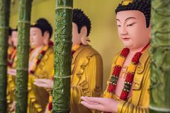 The wall in the temple is filled with buddhas. Religion Buddhism concept. Texture, background Buddhism.  royalty free stock photos