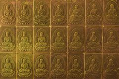 The wall in the temple is filled with buddhas. Religion Buddhism concept. Texture, background Buddhism.  stock images