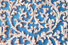 Wall temple. Pattern of flower stucco blue background Royalty Free Stock Photos