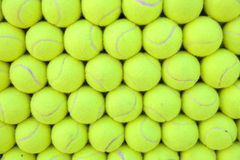 Wall of tennis balls aligned - background. Pattern Stock Photo