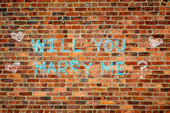Wall with the text :  Wll you marry me? Royalty Free Stock Photos