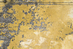 Wall texture. Grungy wall texture yellow and grey wall Royalty Free Stock Image