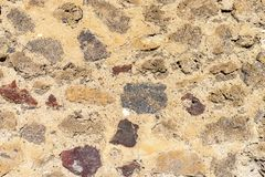 Wall texture of ancient old brick stone. Outdoor exterior house in Pompeii. Solid wall sandstone structure background. Grunge surface, for texturing royalty free stock photo