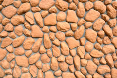 Wall texture of big stones. Building wall texture made of big rough yellow stones pressed into cement Stock Photo