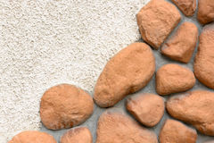 Wall texture of big stones. Building wall texture made of big rough yellow stones pressed into cement Royalty Free Stock Photo