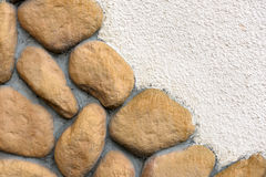 Wall texture of big stones. Building wall texture made of big rough yellow stones pressed into cement Royalty Free Stock Photography
