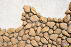 Wall texture of big stones. Building wall texture made of big rough yellow stones pressed into cement Stock Photos