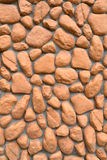 Wall texture of big stones. Building wall texture made of big rough yellow stones pressed into cement Stock Photography