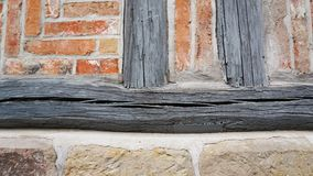 Wall Texture 2. Closeup of wooden beam and vintage brickwork Stock Photos