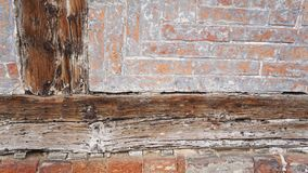 Wall Texture 1. Closeup of wooden beam and vintage brickwork Royalty Free Stock Photo