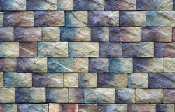 Wall texture of different colored stone blocks Royalty Free Stock Images