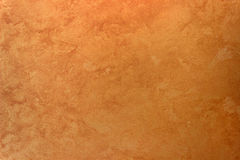 Wall texture orange gold  silk effect Paint background. Stock Image