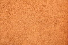 Wall texture with orange stucco relief Royalty Free Stock Images