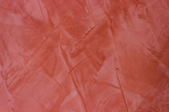 Wall texture red stucco Paint background. Royalty Free Stock Images