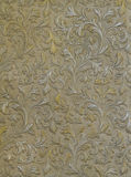 Wall texture with with the silver and gold leaves Royalty Free Stock Photo