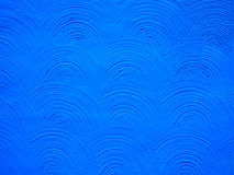 Blue Stucco Background Arc Texture. A wall textured in a blue stucco arc pattern. Background, Photo, Image Royalty Free Stock Photo