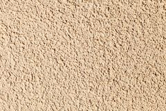 Wall with a textured plaster of beige color. Background image, texture.  royalty free stock photos