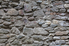 Wall with textured stone blocks Stock Photo