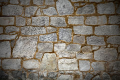 Wall with textured stone blocks Stock Images