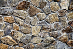 Wall with textured stone blocks Stock Image
