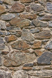 Wall with textured stone blocks Stock Photo