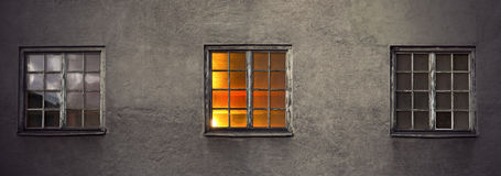 Wall with three windows Stock Images
