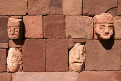 Wall of Tiahuanaco stone faces. Multiple Stone faces built into a wall in Tiahuanaco or Tiwanaku, the capital of the Pre-Inca Civilization in Bolivia Royalty Free Stock Images