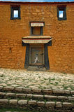 Wall From Tibet With Door. There is an old door of a house in Tibet Stock Photo