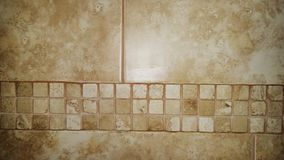 Wall tiles. A close-up of wall tiles stone effects . Mosaic border in a stone colour stock images