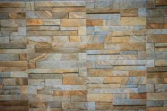 Wall tiles patterned like natural split stone background. Simula Royalty Free Stock Photos