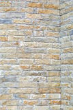 Wall tiles. Stone tiles with rough surface at house wall Royalty Free Stock Photography