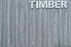 Wall of timber with sign Royalty Free Stock Photos