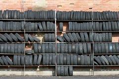 Wall of tires. Over brick, horizontal version stock photo
