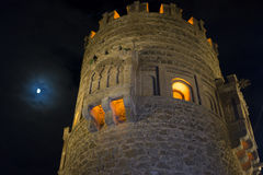 Wall with Toledo gate at night, beautiful building with big door Stock Images