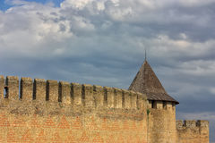 Wall and tower ancient castle in Khotyn. Wall and tower ancient castle in  Khotyn. Blue sky with clouds Stock Photography