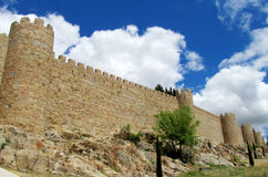 Wall, tower and bastion of Avila, Spain, made of yellow stone bricks Stock Photo
