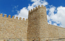 Wall, tower and bastion of Avila, Spain, made of yellow stone bricks Stock Photos