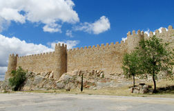 Wall, tower and bastion of Avila, Spain, made of yellow stone bricks Stock Image