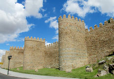 Wall, tower and bastion of Avila, Spain, made of yellow stone bricks Royalty Free Stock Photography
