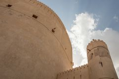 Wall and tower of a desert fort. Defensive wall and guard tower of a desert fort Stock Photo