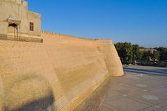 Wall and towers of the ancient citadel in Bukhara `Ark citadel`. stock images