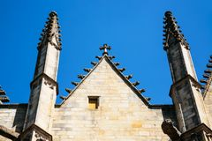 Wall with towers of church Notre-Dame in Vitre town. Travel to France - wall with towers of church Notre-Dame in Vitre town in Ille-et-Vilaine department of Royalty Free Stock Images
