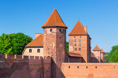 The wall and towers of Malbork castle Stock Photos