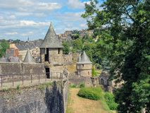 Wall and towers in the Medieval town and Castle of Fougeres, Brittany, northwestern France. Landscape View of the Medieval Castle of the Town of Fougeres with stock photo