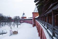 Wall and towers of Novgorod Kremlin. Brick wall and towers of Novgorod Kremlin in winter scene Stock Photography