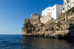 Wall of town over beach in Polignano a Mare. Italy. Royalty Free Stock Image