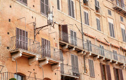 Wall with traditional balconies in Sienna Stock Photo