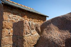 Wall of traditional stone Breton house Stock Photo
