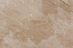 Wall of travertine with stone layers of different colors. Close up architecture macro photography. stock photos