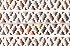 Wall with triangles of different materials in white frames Royalty Free Stock Images